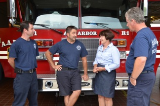 Jane talking with Ann Arbor firefighters